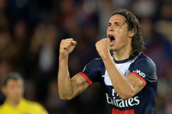 Paris Saint-Germain's forward Edinson Cavani celebrates after scoring a goal during the French L1 football match between Paris Saint-Germain and Ajaccio on August 18, 2013 at the Parc des Princes stadium in Paris. AFP PHOTO / MIGUEL MEDINA