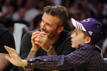 File picture dated 29 April 2012 of British soccer star David Beckham (L) and son Brooklyn (R) attending the Denver Nuggets at Los Angeles Lakers Western Conference Quarterfinal game in Los Angeles, California, USA. Manchester United have been assessing Brooklyn Beckham, with a view to offering him a place in their academy, it was reported 01 November 2013. United's coaching staff have been monitoring the 14-year-old after inviting him to the club where his father made almost 400 appearances, winning the Premier League six times, the FA Cup twice and the European Cup.