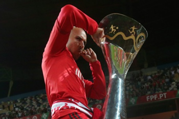 Benfica's Paulo Lopes reacts after damaged the trophy during the celebrations of the Portuguese Candido de Oliveira Supercup, following their soccer match against Rio Ave held at Aveiro Stadium, in Aveiro, 10 August 2014.
