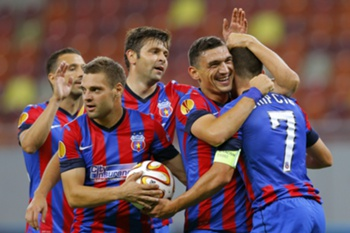 Steaua Bucharest's Claudiu Keseru (2-nd R) celebrates the fifth goal for his team together with his teammates Lucian Sanmartean (L), Adrian Popa (2-nd L), Raul Rusescu (C), and Alexandru Chipciu (R) during their UEFA Europa League, group J, soccer match against Aalborg BK, held on National Arena stadium in Bucharest, Romania, 18 September 2014. Steaua defeated Aalborg BK with a final score of 6-0.