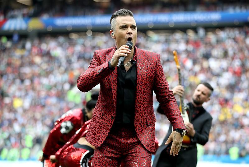 Robbie Williams regressa aos Take That para um concerto único, grátis e virtual - Música - MAGG