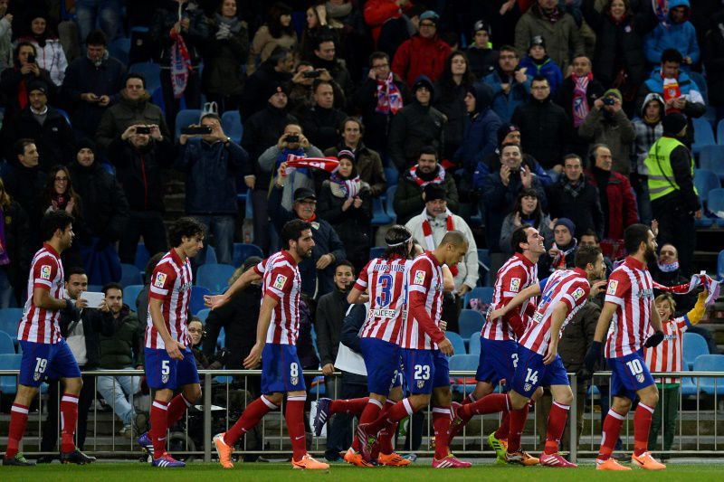 godin_golo_atletico_madrid_geral_festa_afp_2014.jpg • Atletico Madrid's Uruguayan defender Diego Godin (3rdR) celebrates after scoring during the Spanish Copa del Rey (King's Cup) round of 16 second-leg football match Club Atletico de Madrid vs Valencia CF at the Vicente Calderon stadium in Madrid on January 14, 2014.   AFP PHOTO/ PIERRE-PHILIPPE MARCOU • AFP ImageForum; PIERRE-PHILIPPE MARCOU