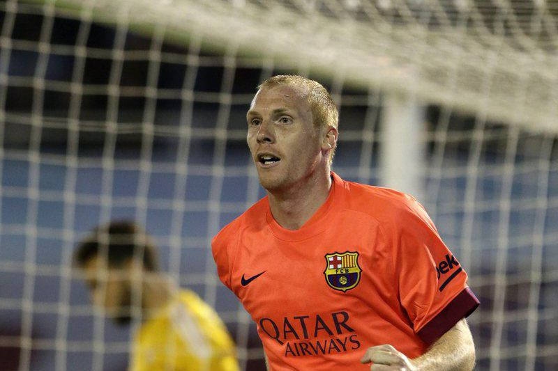 Celta vs FC Barcelona • epa04693209 FC Barcelona's Jeremy Mathieu celebrates after scoring against Celta during the Spanish Liga Primera Division soccer match between Celta and Barcelona at Balaidos stadium, in Vigo, Spain, 05 April 2015.  EPA/Lavandeira Jr. • Lusa