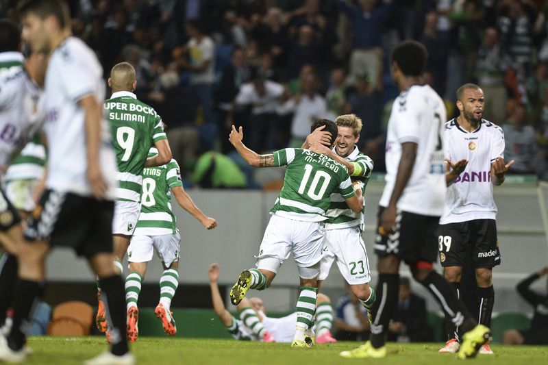 sporting - guimaraes • Sporting's Colombian forward Fredy Montero celebrates with his teammate Sporting's midfielder Adrien Silva after scoring against CD Nacional during the Portuguese Liga football match Sporting CP vs CD Nacional at the Alvalade stadium in Lisbon on September 21, 2015.    AFP PHOTO/ PATRICIA DE MELO MOREIRA