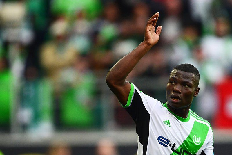 Junior Malanda • epa04164681 Wolfsburg's Junior Malanda celebrates after scoring the 3-1 lead during the German Bundesliga soccer match between VfL Wolfsburg and FC Nuernberg in Wolfsburg, Germany, 12 April 2014. Wolfsburg won 4-1.  (ATTENTION: Due to the accreditation guidelines, the DFL only permits the publication and utilisation of up to 15 pictures per match on the internet and in online media during the match.)  EPA/PETER STEFFEN