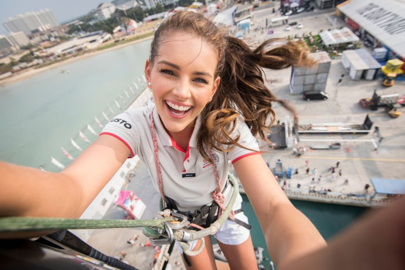 February 05, 2015. Rolene Strauss, Miss World 2014, at the top of the Dongfeng Race Team mast in the Volvo Ocean Race Village in Sanya.