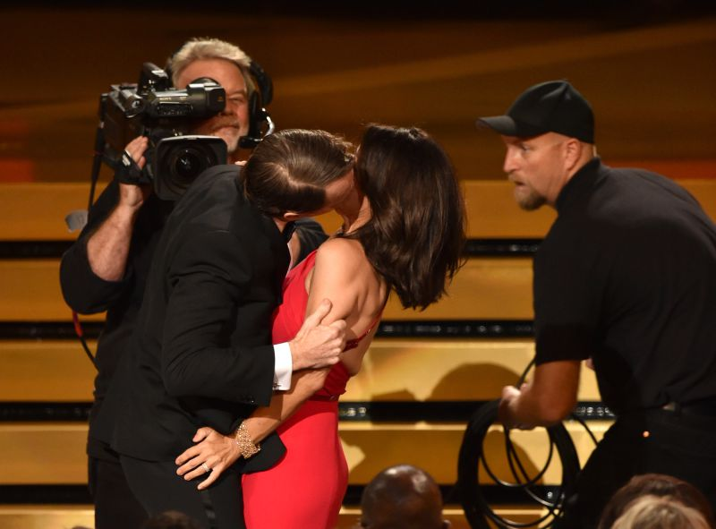 LOS ANGELES, CA - AUGUST 25: Actress Julia Louis-Dreyfus (R) wins Outstanding Lead Actress in a Comedy Series for 'Veep' and kisses actor Bryan Cranston (L) onstage at the 66th Annual Primetime Emmy Awards held at Nokia Theatre L.A. Live on August 25, 2014 in Los Angeles, California.   Kevin Winter/Getty Images/AFP