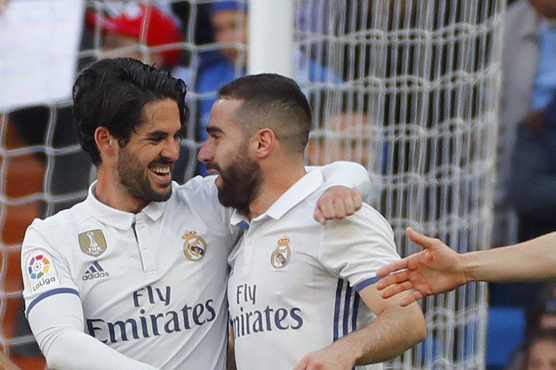 Real Madrid vs. Deportivo Alaves • epa05884749 Real Madrid's Spanish midfielder Isco (L) celebrates with Carvajal (2L), Cristiano Ronaldo (2R) and Nacho after scoring the 2-0 goal against Deportivo Alaves during a Spanish Primera Division League soccer match at the Santiago Bernabeu stadium in Madrid, Spain, 02 April 2017. EPA/BALLESTEROS