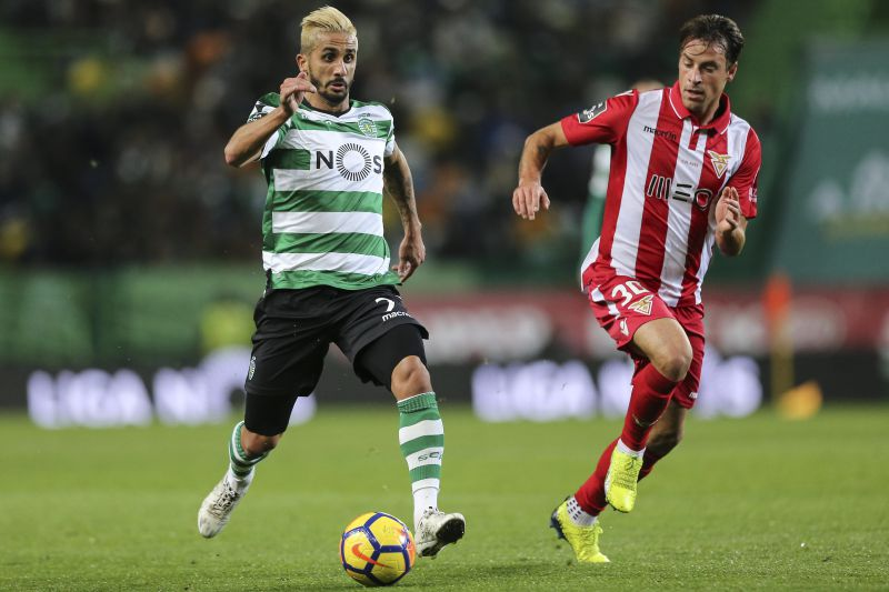 Sporting CP Ruben Ribeiro (L) fights for the ball with Vitor Gomes (R) of Desportivo das Aves during the Portuguese First League soccer match at Alvalade XXI stadium in Lisbon, Portugal