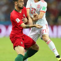 epa06811016 Bruno Fernandes (L) of Portugal in action against David Silva (R) of Spain during the FIFA World Cup 2018 group B preliminary round soccer match between Portugal and Spain in Sochi, Russia, 15 June 2018.  (RESTRICTIONS APPLY: Editorial Use Only, not used in association with any commercial entity - Images must not be used in any form of alert service or push service of any kind including via mobile alert services, downloads to mobile devices or MMS messaging - Images must appear as still images and must not emulate match action video footage - No alteration is made to, and no text or image is superimposed over, any published image which: (a) intentionally obscures or removes a sponsor identification image; or (b) adds or overlays the commercial identification of any third party which is not officially associated with the FIFA World Cup)  EPA/FRIEDEMANN VOGEL   EDITORIAL USE ONLY