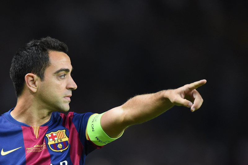 Juventus FC vs FC Barcelona • epa04786968 Barcelona's Xavi Hernandez gestures during the UEFA Champions League final soccer match between Juventus FC and FC Barcelona at Olympiastadion in Berlin, Germany, 06 June 2015.  EPA/MARCUS BRANDT • Lusa