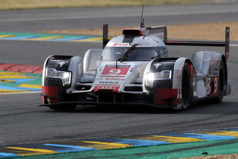 epa04798486 Audi Sport Team Joest in an Audi R18 E - Tron Quattro with Filipe Albuquerque of Portugal, Marco Bonanomi of Italy and Rene Rast of Germany (F) take part in the Le Mans 24 Hours race in Le Mans, France, 14 June 2015. The race started at 3pm a day earlier and is scheduled to finish at 3pm on 14 June.  EPA/EDDY LEMAISTRE