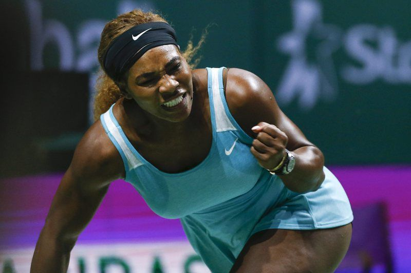 Serena Williams na final do WTA Championship • Serena Williams of the United States reacts during her match against Eugenie Bouchard of Canada at the BNP Paribas WTA Finals 2014 at the Singapore Indoor Stadium, 23 October 2014. • EPA/WALLACE WOON