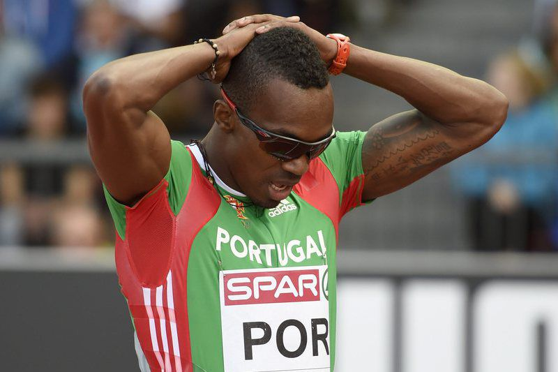 Athletics European Championships 2014 • epa04356486 Portugal's Yazaldes Nascimento reacts after the men's 4x100m relay round 1 race, at the fifth day of the European Athletics Championships in the Letzigrund Stadium in Zurich, Switzerland, Saturday, August 16, 2014.  EPA/JEAN-CHRISTOPHE BOTT • Lusa