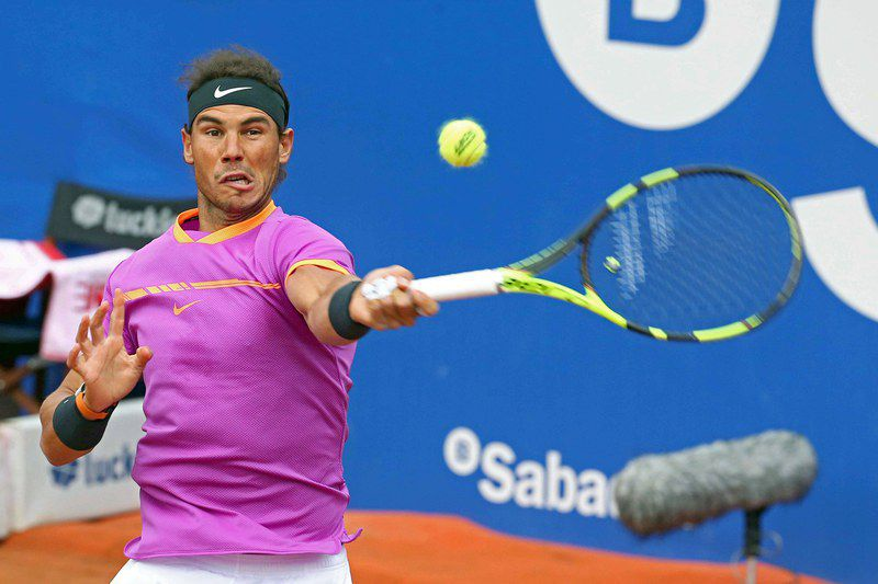 Barcelona Open tennis tournament • epa05937278 Rafael Nadal of Spain returns a ball to Dominic Thiem from Austria during the final match of the Barcelona Open Banc Sabadell, Trofeo Conde de Godo, in Barcelona, Spain, 30 April 2017.  EPA/TONI ALBIR • Lusa