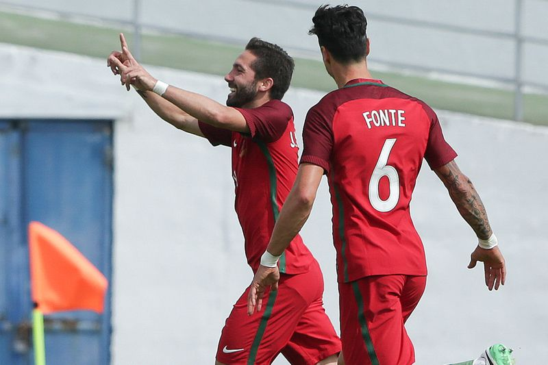 Portugal vs Cyprus • Portuguese national soccer team players Joao Moutinho (L) and Jose Fonte (L) celebrate the scoring of a goal against Cyprus during their friendly match between Portugal and Cyprus  at Antonio Coimbra da Mota Stadium in Estoril, outskirts of Lisbon, Portugal, 03 June 2017. TIAGO PETINGA/LUSA • © 2017 LUSA - Agência de Notícias de Portugal, S.A.