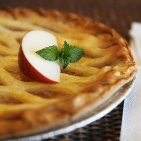 Warm apple pie with apple and mint on top