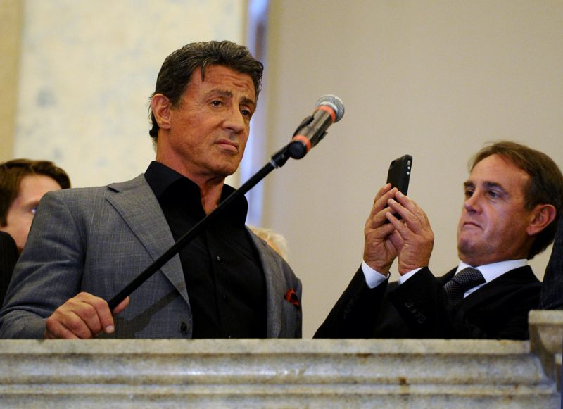 US actor and film director Sylvester Stallone (L) gives a press conference during the opening of the art exhibition