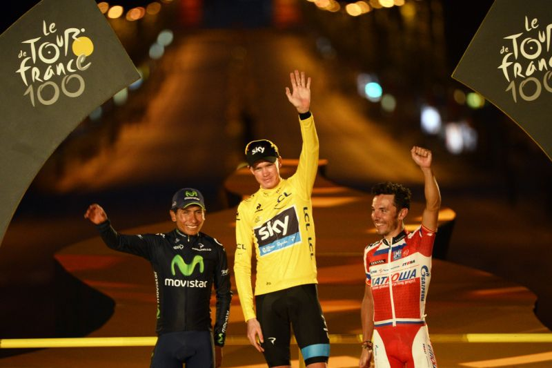 Tour de France 2013 winner Britain's Christopher Froome, Second-placed in the overall standings and best climber's polka dot jersey Colombia's Nairo Quintana (L), Third-placed in the overall standings Spain's Joaquim Rodriguez Oliver (R) poses on the podium in Paris on the Champs-Elysee avenue, at the end of the 133.5 km twenty-first and last stage of the 100th edition of the Tour de France cycling race on July 21, 2013 between Versailles and Paris.  AFP PHOTO / POOL / STEPHANE MANTEY