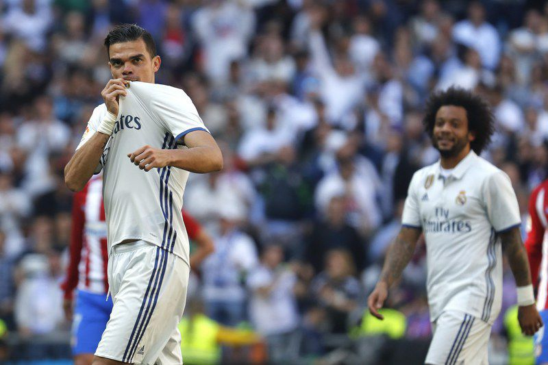 REAL MADRID VS ATLETICO MADRID • epa05897280 Real Madrid's Portuguese defender Pepe (L) celebrates scoring the opening goal during the Primera Division match between Real Madrid and Atletico Madrid played at Santiago Bernabeu stadium in Madrid, Spain on 08 April 2017.  EPA/BALLESTEROS • BALLESTEROS/EPA