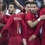 ec117c682d ... Jogadores portugueses festejam o primeiro golo  EPA MELANIE DUCHENE ...