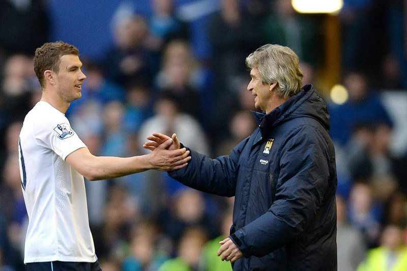 Everton vs Manchester City  • Manchester City's Edin Dzeko (C-L) and manager Manuel Pellegrini (C-R) shake hands in celebrations at the end of the English Premier League soccer match between Everton and Manchester City at the Goodison Park, Liverpool, Britain, 03 May 2014. EPA/PETER POWELL https://www.epa.eu/files/Terms%20and%20Conditions/DataCo_Terms_and_Conditions.pdf •   ; PETER POWELL; epa04190264