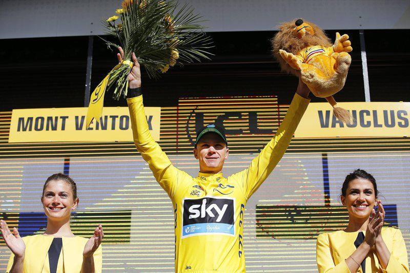 Tour de France 2016 - 12th stage • epa05424723 British rider Christopher Froome (C) of Team Sky celebrates on the podium after retaining the overall leader's yellow jersey following the 12th stage of the 103rd edition of the Tour de France cycling race over 184km between Montpellier and Mont Ventoux, France, 14 July 2016.  EPA/YOAN VALAT • Lusa