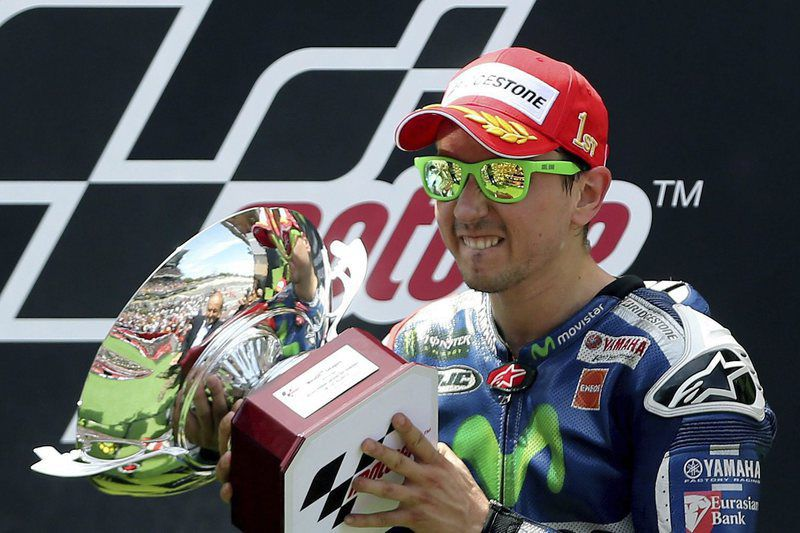 Catalonian Motorcycling Grand Prix • epa04799020 Spanish Moto GP driver Jorge Lorenzo of Yamaha celebrates his victory at the podium of the Catalonian Grand Prix held at of Montmelo's track in Barcelona, Spain on 14 June 2015.  EPA/ANDREU DALMAU • Lusa