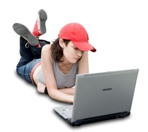 Teenager/Student With Laptop On White Background (+clipping path for easy background removing if needed)