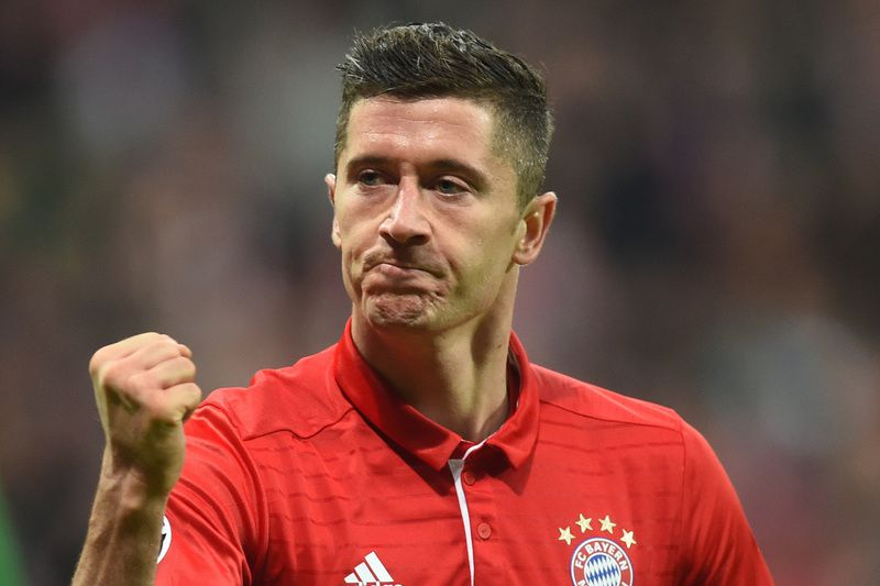 Robert Lewandoski • (FILES) This file photo taken on October 19, 2016 shows Bayern Munich's Polish striker Robert Lewandowski celebrating after the third goal for Munich during the Champions League group D match between FC Bayern Munich and PSV Eindhoven at the stadium in Munich, southern Germany.   Bayern extends Lewandowski's contract to 2021, announced the club on Tuesday. / AFP PHOTO / CHRISTOF STACHE • CHRISTOF STACHE / AFP