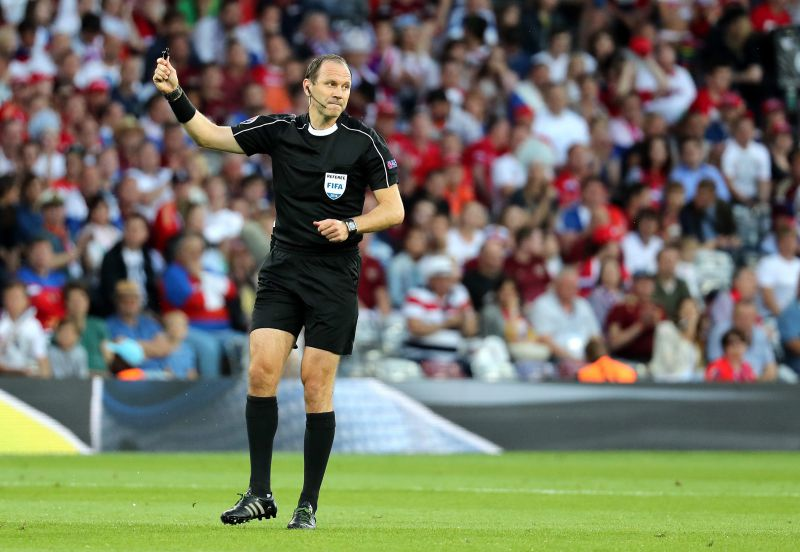 epa05380391 Swedish referee Jonas Eriksson gestures during the UEFA EURO 2016 group B preliminary round match between Russia and Wales at Stade Municipal in Toulouse, France, 20 June 2016.  (RESTRICTIONS APPLY: For editorial news reporting purposes only. Not used for commercial or marketing purposes without prior written approval of UEFA. Images must appear as still images and must not emulate match action video footage. Photographs published in online publications (whether via the Internet or otherwise) shall have an interval of at least 20 seconds between the posting.)  EPA/KHALED ELFIQI   EDITORIAL USE ONLY