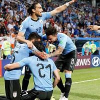 Uruguaios celebram o segundo golo marcado @EPA/JUAN HERRERO