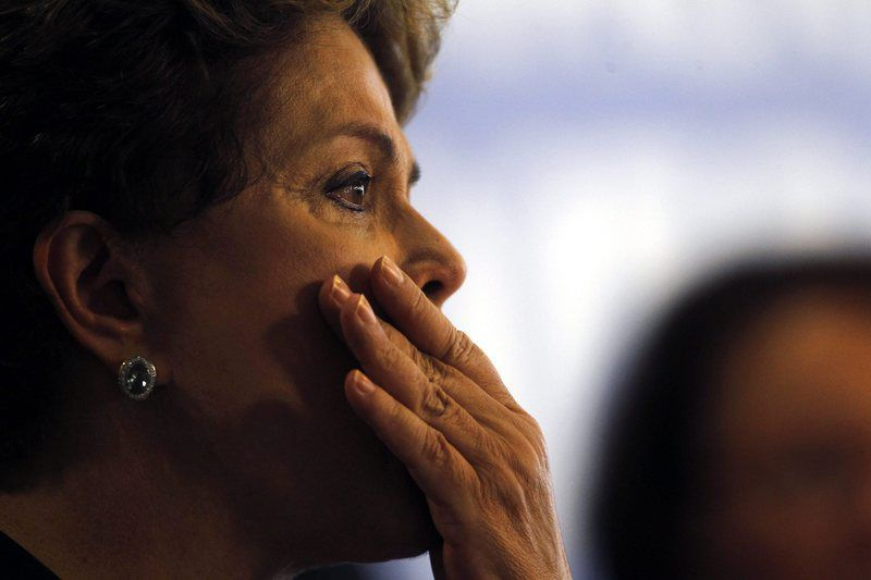 Report of the Commission of Truth about human rights violations during the last dictatorship • epa04523351 Brazilian president Dilma Rousseff reacts as she speaks during the delivery of the Commission of Truth final report about human rights violations of the last dictatorship (1964-1985) at Planalto Palace in Brasilia, Brazil, 10 December 2014. The report explains in detail about the 434 dead and missing people during the dictatorship. Rousseff, who suffered tortures for her conection with groups against the military regime during three years of prison when she was young, reacts in tears delivering a speech about the 4,500 pages report of thousands of tortures and chasing cases.  EPA/FERNANDO BIZZERA JR.