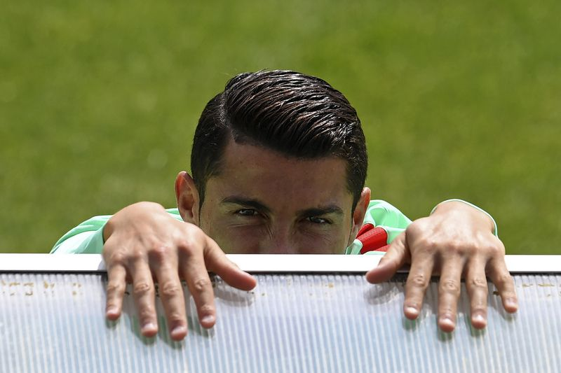 Ronaldo • Portugal's forward Cristiano Ronaldo is pictured ahead of a training session at the team's base camp in Marcoussis, south of Paris, on June 19, 2016, during the Euro 2016 football tournament. / AFP PHOTO / FRANCISCO LEONG • AFP or licensors