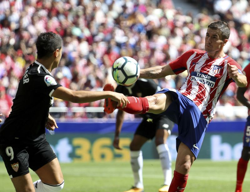 Atletico Madrid's Gabi Fernandez (R) vies for the ball with Sevilla's Ben Yedder during the Spanish Primera Division Liga match between Atletico Madrid and Sevilla at Wanda Metropolitano stadium in Madrid, Spain, 23 September 2017