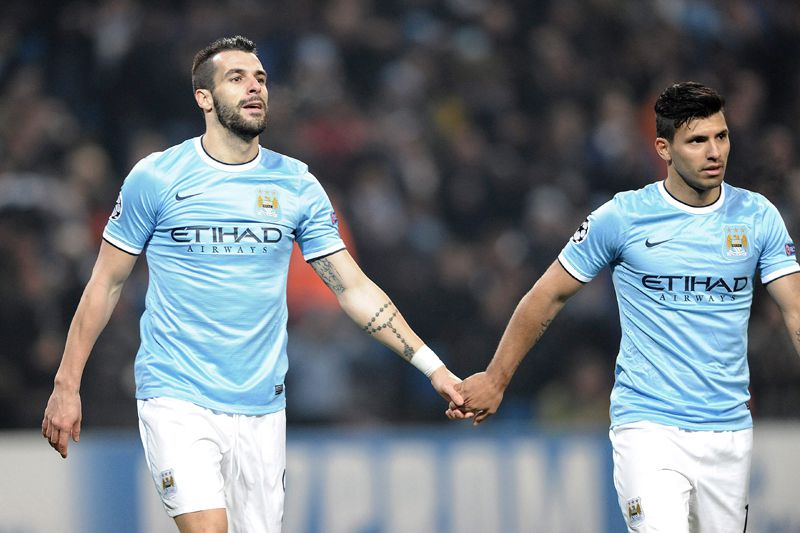 Negredo e Aguero • AFP@Peter Powell