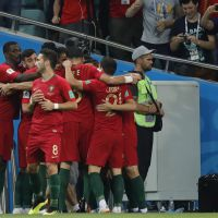 epa06811092 Players of Portugal celebrates the 1-0 goal during the FIFA World Cup 2018 group B preliminary round soccer match between Portugal and Spain in Sochi, Russia, 15 June 2018.  (RESTRICTIONS APPLY: Editorial Use Only, not used in association with any commercial entity - Images must not be used in any form of alert service or push service of any kind including via mobile alert services, downloads to mobile devices or MMS messaging - Images must appear as still images and must not emulate match action video footage - No alteration is made to, and no text or image is superimposed over, any published image which: (a) intentionally obscures or removes a sponsor identification image; or (b) adds or overlays the commercial identification of any third party which is not officially associated with the FIFA World Cup)  EPA/RONALD WITTEK   EDITORIAL USE ONLY