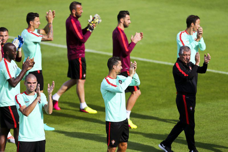 Portugal training • epa05353742 Portuguese national soccer team players (front row, L-R) Pepe, Cristiano Ronaldo, and head coach Fernando Santos applaud fans during their team's training session in Marcoussis, France, 09 June 2016. The Portuguese team prepares for the UEFA EURO 2016 soccer championship that starts on 10 June 2016.  EPA/MIGUEL A. LOPES • Lusa
