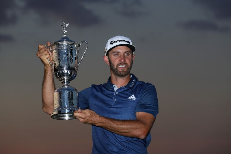 Dustin Johnson conquista primeiro grande título da carreira no US Open em golfe • SAM GREENWOOD / GETTY IMAGES NORTH AMERICA / AFP