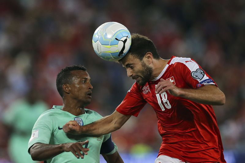 Group B qualifier for the World Championship FIFA 2018 - Switzerland vs Portugal ? Swiss player Stephan Admir Mehmedi (R) heading for the ball together with portuguese oponent Nani (L) during the Group B qualifier for the World Championship FIFA 2018, at the St. Jakob-Park stadium in Basel, Switzerland. JOS