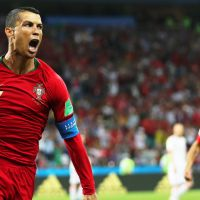 epa06811038 Cristiano Ronaldo (L) of Portugal celebrates after scoring the 1-0 lead from the penalty spot during the FIFA World Cup 2018 group B preliminary round soccer match between Portugal and Spain in Sochi, Russia, 15 June 2018.  (RESTRICTIONS APPLY: Editorial Use Only, not used in association with any commercial entity - Images must not be used in any form of alert service or push service of any kind including via mobile alert services, downloads to mobile devices or MMS messaging - Images must appear as still images and must not emulate match action video footage - No alteration is made to, and no text or image is superimposed over, any published image which: (a) intentionally obscures or removes a sponsor identification image; or (b) adds or overlays the commercial identification of any third party which is not officially associated with the FIFA World Cup)  EPA/FRIEDEMANN VOGEL   EDITORIAL USE ONLY