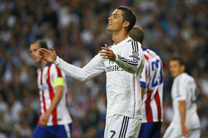 Real Madrid vs Atletico Madrid • epa04716655 Real Madrid's Cristiano Ronaldo reacts during the UEFA Champions League quarter final second leg soccer match between Real Madrid and Atletico Madrid at Santiago Bernabeu stadium, in Madrid, Spain, 22 April 2015.  EPA/JUANJO MARTIN • Lusa