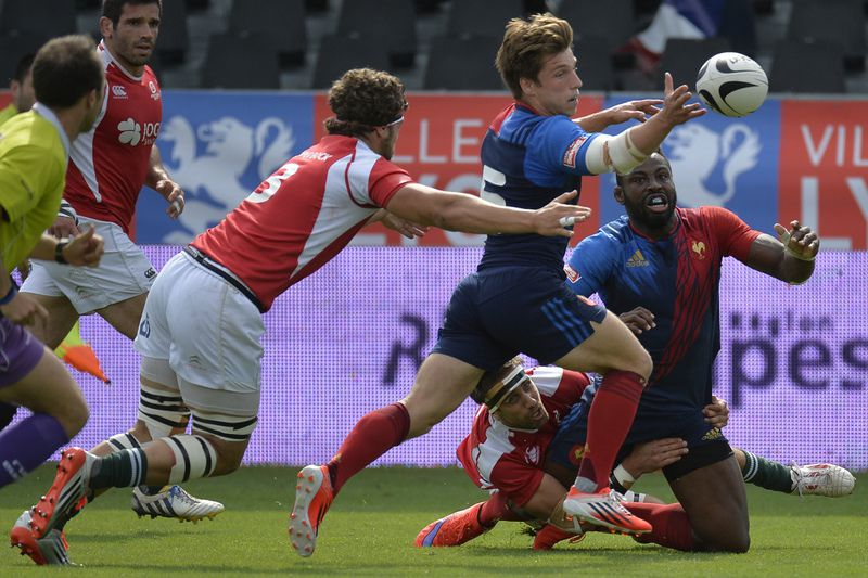 Portugal segue em frente no Sevens Grand Prix Series • JEAN-PHILIPPE KSIAZEK / AFP