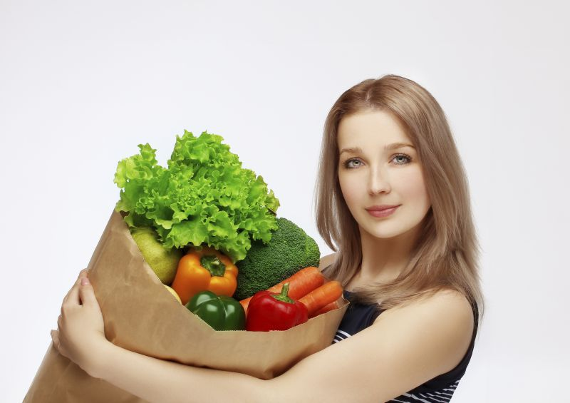Woman with bag of fresh groceries