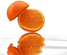 A cut orange isolated on white background with reflection