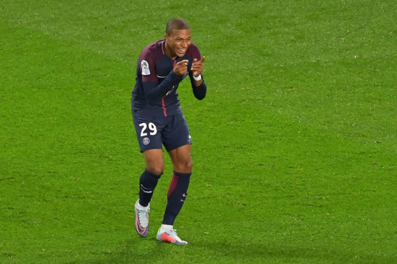Paris Saint-Germain's French forward Kylian Mbappe reactes after he scored the team's second goal during the French L1 football match between Paris Saint-Germain and Olympique Lyonnais at the Parc des Princes Stadium in Paris on September 17, 2017.  ALAIN JOCARD / AFP