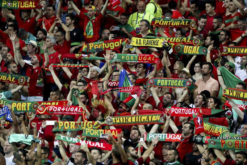 Euro 2016 Semi Final  Portugal vs Wales • Portugal supporters celebrate in the end of the UEFA EURO 2016 semi final match between Portugal and Wales with the final result of 2-0 at Parc Olympique Lyonnais Stadium in Lyon, France, 6 of July 2016. MIGUEL A. LOPES/LUSA • Lusa