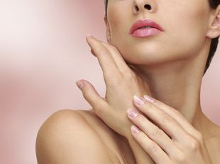Beauty woman hands with health skin on pink background