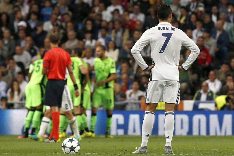 REAL MADRID VS SPORTING PORTUGAL • epa05539883 Real Madrid's Portuguese striker Cristiano Ronaldo reacts during the UEFA Champions League group stage match between Real Madrid and Sporting CP at Santiago Bernabeu Stadium in Madrid, Spain, 14 September 2016.  EPA/KIKO HUESCA • Lusa