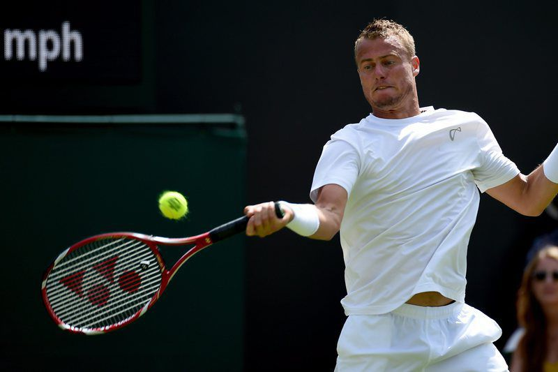 Wimbledon Championships • epa04823905 Lleyton Hewitt of Australia in action against Jarkko Nieminen of Finland during their first round match for the Wimbledon Championships at the All England Lawn Tennis Club, in London, Britain, 29 June 2015.  EPA/ANDY RAIN • Lusa